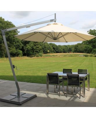 tilting cantilever with white canopy  open over a patio table in a garden