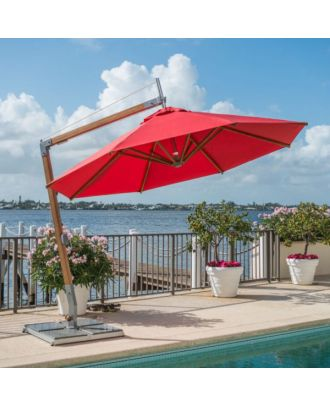 small cantilever parasol with red canopy and rotating base on pool side