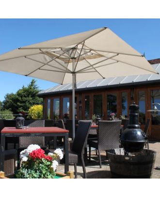all weather parasol on a restaurant terrace shading a square table with chairs