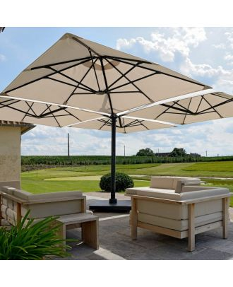 extra large parasol shading patio table in a garden