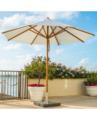 large garden umbrella on terrace with flowers