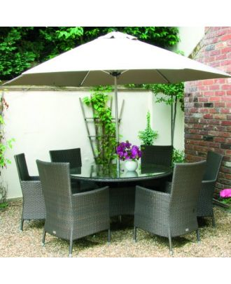 small garden parasol with white canopy, covering patio table with chairs