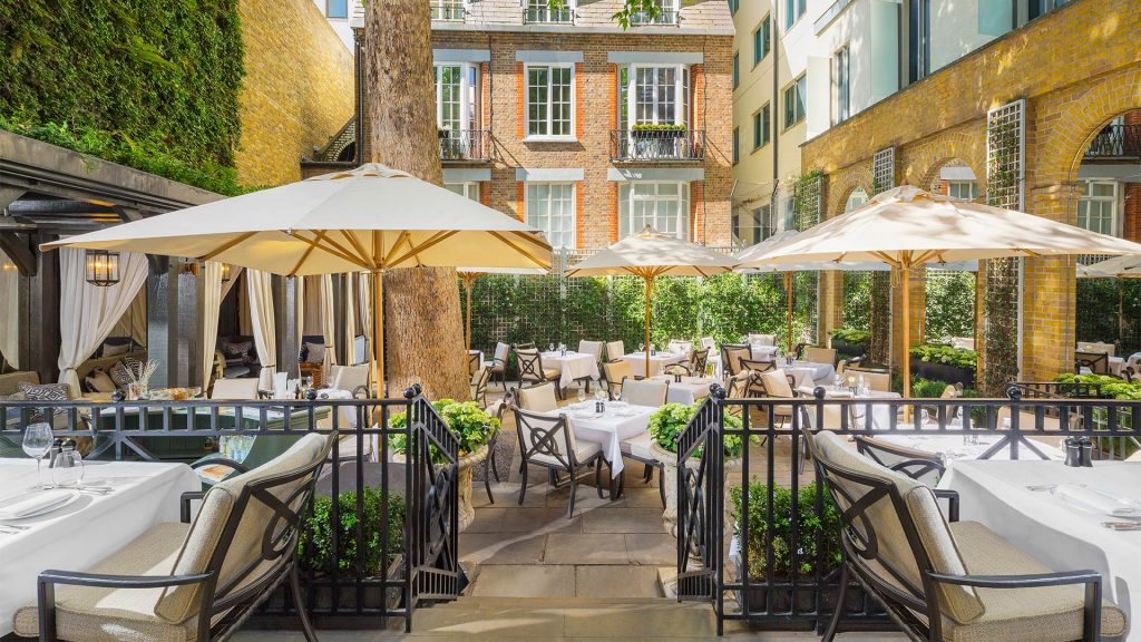 parasols over restaurant tables and chairs
