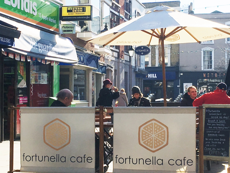 coffee shop with parasol and cafe barriers