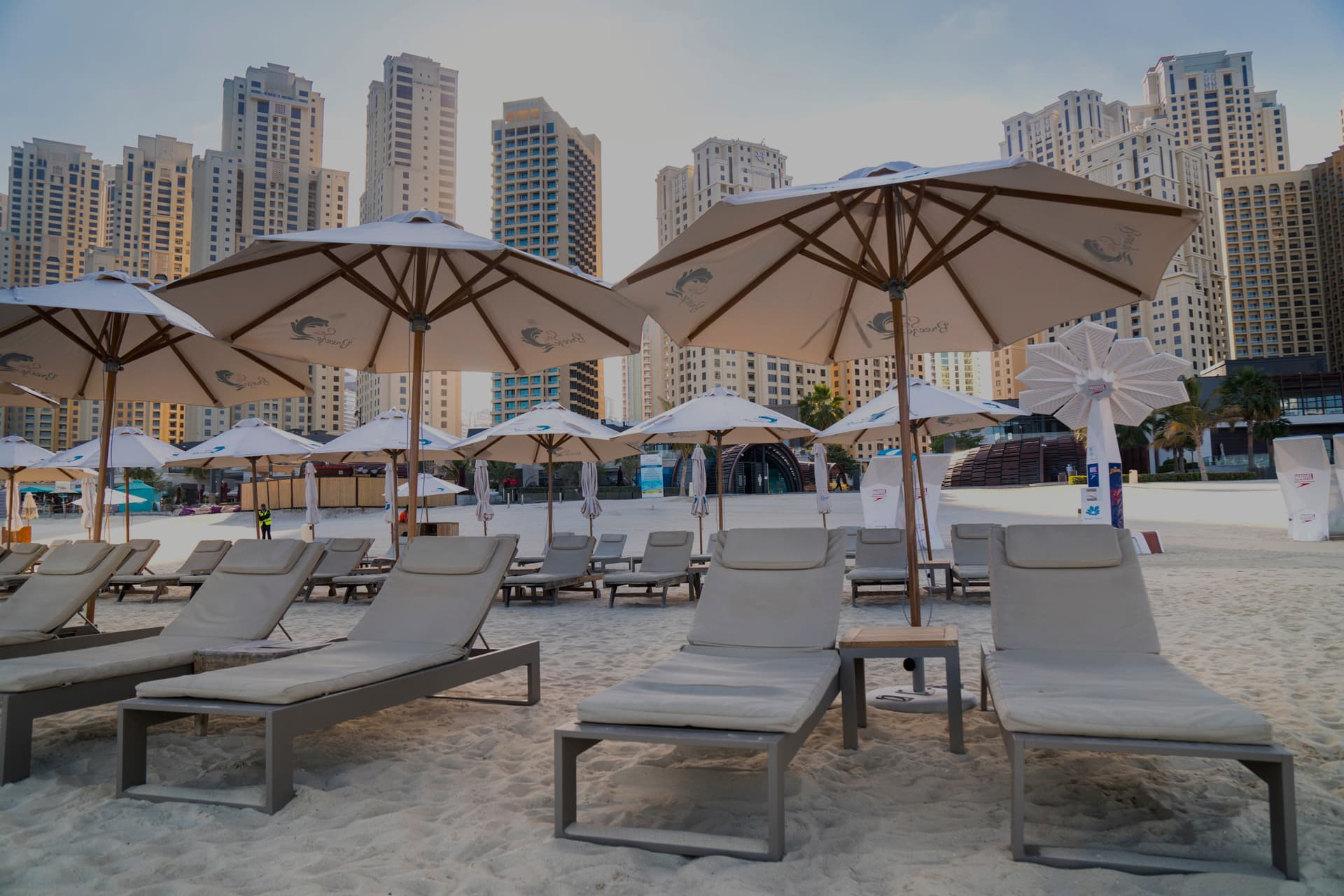 parasols on the beach next to hotels