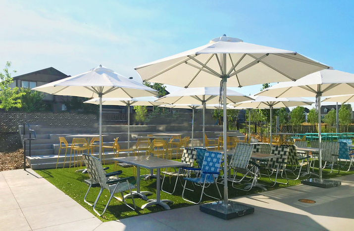 used commercial parasols on restaurant terrace