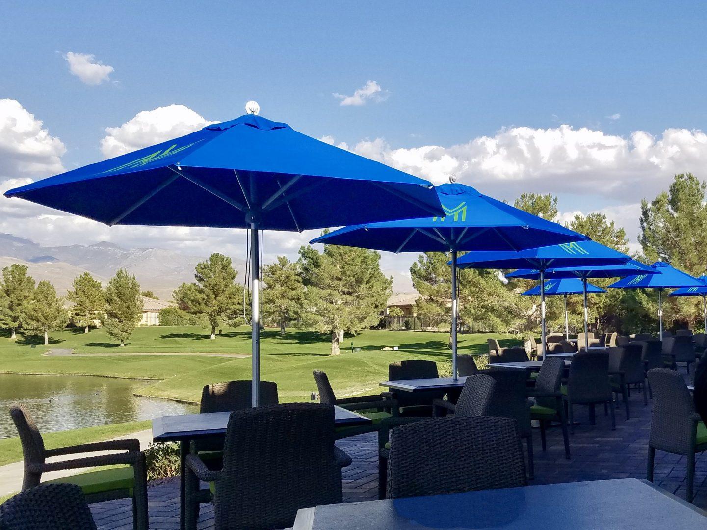 parasols on golf club, near a lake