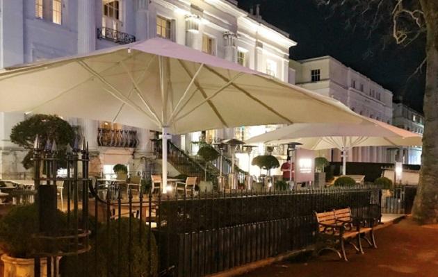 large commercial parasol on a pub terrace