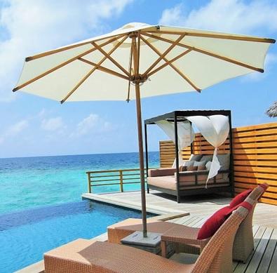 parasol and sunchairs on a beach