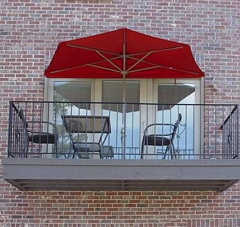 half parasol for balcony with red canopy and chairs