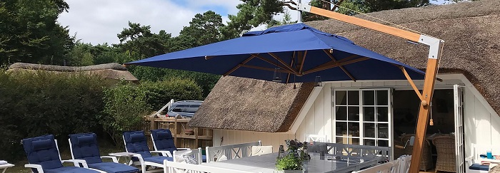 navy parasol next to old house on a deck