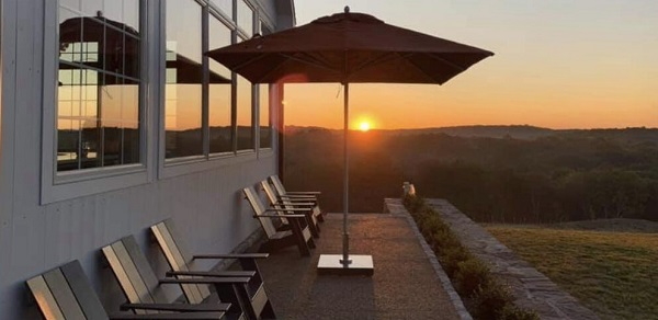 parasol on a terrace with sunset in background