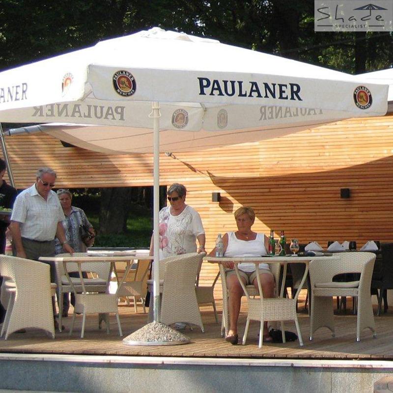 white branded parasol - paulaner