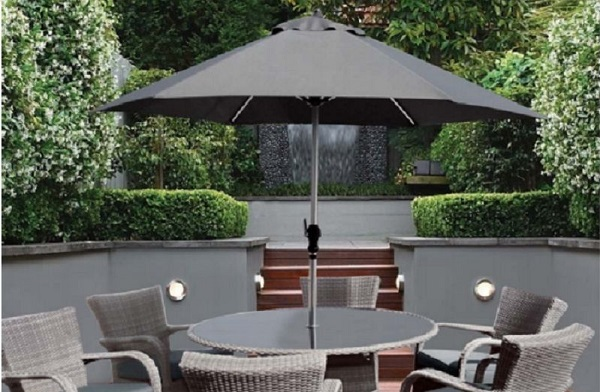 small balcony parasol with round table and chairs