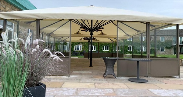giant parasol in hospitality with side screens